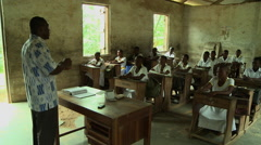PAKRO TEACHER LECTURES TO STUDENTS IN CLASSROOM Stock Footage