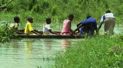 STUDENTS IN WOODEN CANOE IN DENSU RIVER 2 - PUSHPOLE ACTION Stock Footage