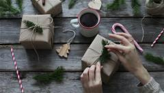 Girl packs gifts and graces for the new year Stock Footage