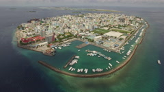 Aerial shot of Male, Maldives Island - crowded city, metropolis at ocean  Stock Footage