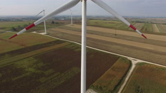 Aerial shot of wind turbine in countryside - Camera crane Stock Footage