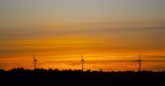 Wind turbines farm at sunset - renewable energy Stock Footage