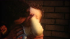 1948: Dad tickling newborn baby kisses playtime happy smiles. Stock Footage