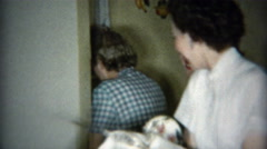 1953: Girlfriends hiding from camera while drying dishes. Stock Footage