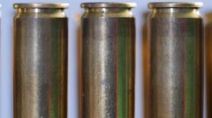 A Dolly shot of large caliber bullets in a production line Stock Footage