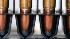 A Dolly shot of large caliber bullets in production line Stock Footage