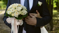 Bride embraces bridegroom . view of the hands of the bride - stock footage
