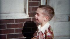 1954: Boy crying in vintage 50's Hawaiian print collar button down shirt. Stock Footage