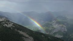 Double rainbow in the mountains Stock Footage