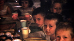 1954: Well mannered co-ed children's birthday party cupcakes ready. - stock footage