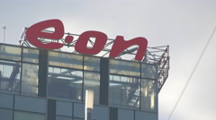 E-on sign on a skyscraper in the Free Press Square, Bucharest Stock Footage