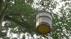 Wooden bucket hanging in a tree at the Village Museum in Bucharest Stock Footage