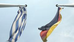 Greece flag Germany flag seen from below Stock Footage