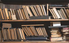 Old books in a vintage library Stock Photos