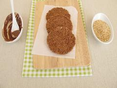 Homemade chocolate coins with amaranth - stock photo