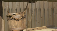 Wooden bucket chained to an old well at the Village Museum in Bucharest Stock Footage