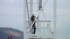 The installer climbs the tower up. - stock footage