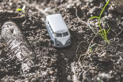 Vintage bus VW. Small metal toy in the nature - stock photo