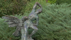Statue of a man and an eagle in Herăstrău Park, Bucharest Stock Footage