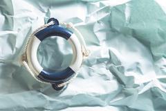 Lifebelt on blue background - stock photo