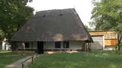 Thatched roof house at the Village Museum in Bucharest Stock Footage