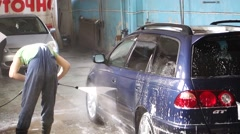 Washing a car with water Stock Footage