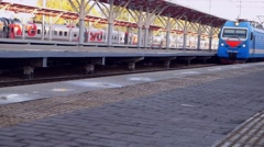 Arriving train in a railway station at Vokzal Russia.  Stock Footage