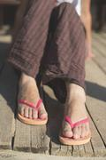Foot in thongs - stock photo