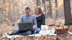 couple with laptop - stock footage