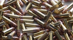 Dolly shot of pile of .22 ammunition bullets Stock Footage