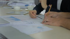 Closeup view of a colleagues financier, trader using a pencil to draw a line on Stock Footage