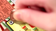 Stock Video Footage of Scratching lottery ticket