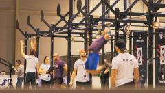 Athletes are catching up on a horizontal bar - stock footage