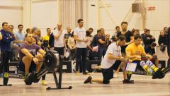Athletes are rowing on a rowing machine Stock Footage