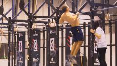 Athlete is catching up on a horizontal bar Stock Footage