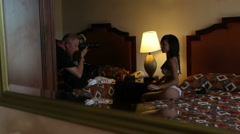 Stock Video Footage of backstage of the photo-shoot with lingerie model in a hotel room