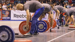 Many volunteers fast set the barbells - stock footage