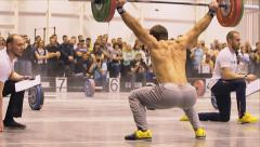 Athlete lifts a barbells one by one - stock footage