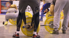 Lot of volunteers fast set the barbells - stock footage