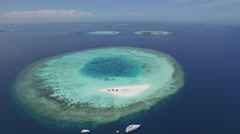 Aerial shot of tropical coral reefs and atolls in Maldives island Stock Footage