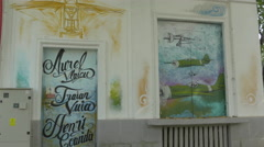 Aurel Vlaicu, Traian Vuia and Henri Coandă names painted on a wall in Bucharest Stock Footage