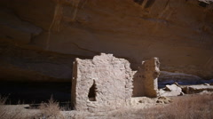 Stock Video Footage of Time Lapse of Native American Ruin under Moon Light -Pan Right-