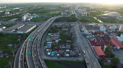 Aerial View of overpass u-turn road in thailand suburb Stock Footage