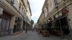 Tourists and waiter walking by Pizza al Forno restaurant in Bucharest Stock Footage