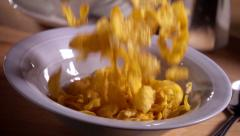 Cornflakes fall into bowl in slow motion Stock Footage