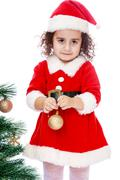 girl decorates the Christmas tree - stock photo