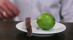Cut a lime closeup Stock Footage