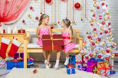 Joyful girl who gave a great gift at each other in a Christmas setting - stock photo