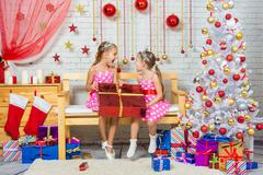 Joyful girl who gave a great gift and shout at each other - stock photo