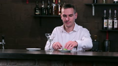 Bartender at work behind the bar - stock footage